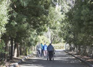 Elderly residents walking on pathway near Japara Anglesea aged care home