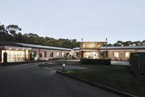 Exterior at Japara Anglesea aged care home after dark