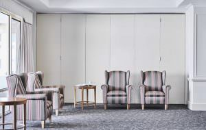 Plush chairs in common living room at Japara Anglesea aged care home