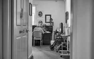 Elderly male resident sitting in bedroom at Japara Anglesea aged care home
