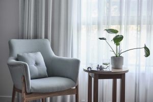 Close up of chair and bedside table in bedroom at Japara Noosa aged care home