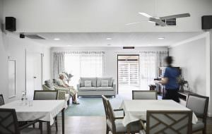 Dining room at Japara Noosa aged care home with elderly female resident