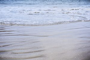 Close up of water on beach near Japara Elouera aged care home