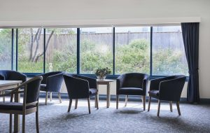 Chairs in lounge room at Japara Elouera aged care home