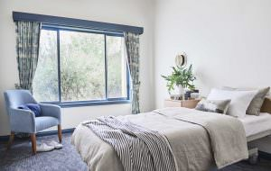 Bedroom at Japara Elouera aged care home with window view