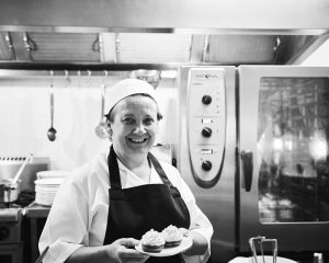 Smiling female cook at Japara Yarra West aged care home