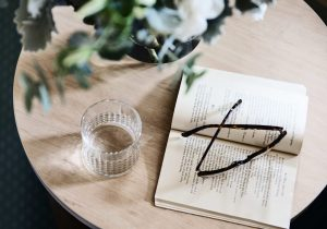 Close up of book and reading glasses at Japara Yarra West aged care home