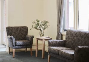 Close up of plush chairs and table at Japara Yarra West aged care home