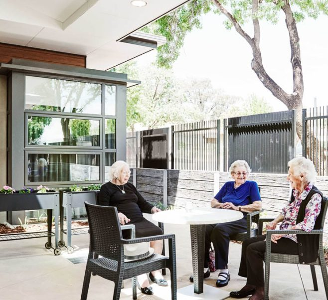 Residents enjoying an outdoor area at Japara Mirridong Aged Care
