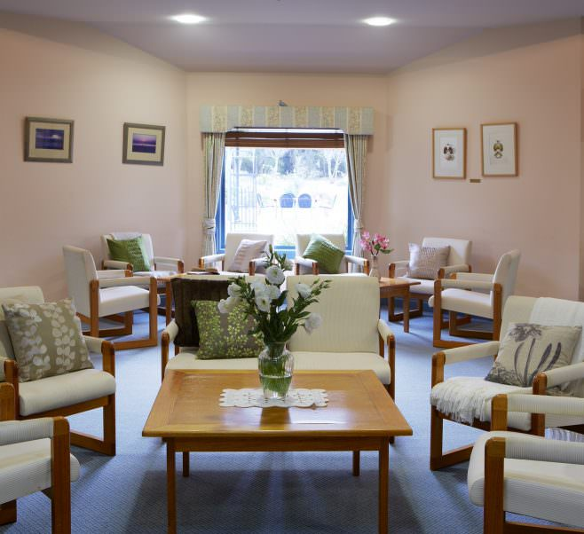 Living room with outdoor view at Japara Elouera aged care home