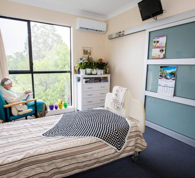 Bedroom with elderly resident at Japara Gympie aged care home