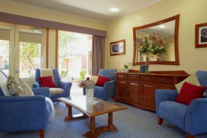 Living room with outside view at Japara Kelaston aged care home