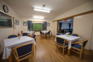 Dining room in evening at Japara Kiverton Park aged care home