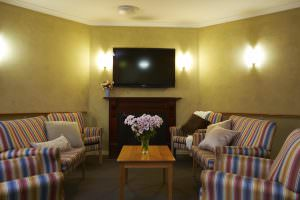 Living room with fireplace at Japara Lower Plenty aged care home
