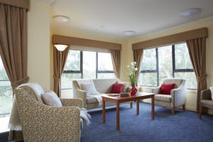 Living room with blue carpet at Japara Millward aged care home