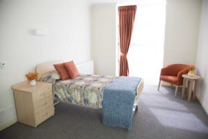Bedroom with carpet floor at Japara Mirridong aged care home