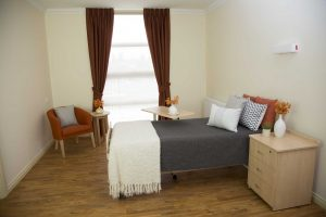 Bedroom with wooden floor at Japara Mirridong aged care home