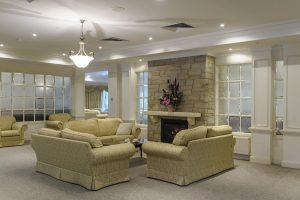 Living room with fireplace at Japara Narracan Gardens aged care home