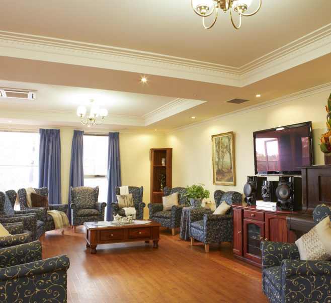 Living room with wooden floor at Japara Rosanna Views aged care home