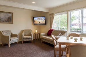 Living room with courtyard view at Japara Strzelecki House aged care home