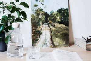 Close up of side table in bedroom at Japara Scottvale aged care home with water bottle and book