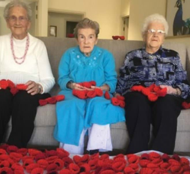 Kirralee residents and their hand-made poppies.