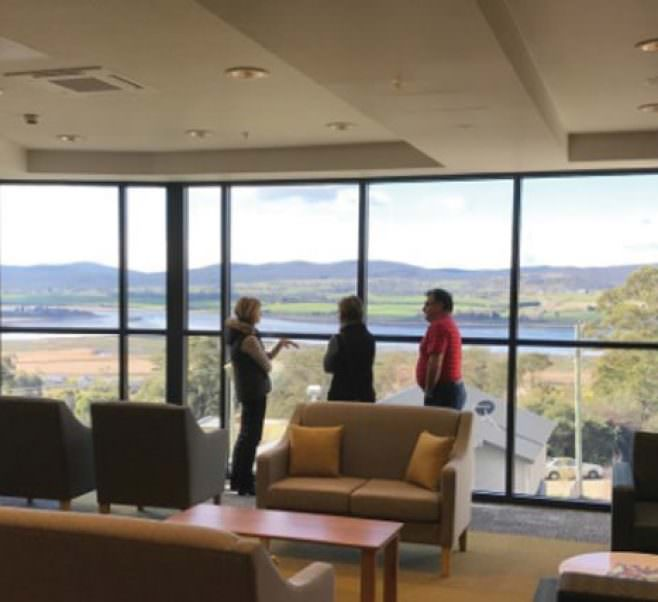 Visitors enjoy the view from level 2 of Riverside Views