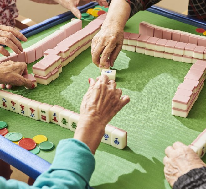 Residents playing Mah Jong at Japara Forest View aged care home
