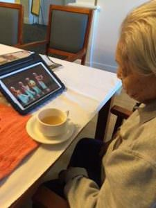 Lai watching Chinese Opera on a tablet at the Japara Central Park aged care home