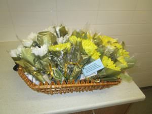 a small basket of flowers for those who have passed away