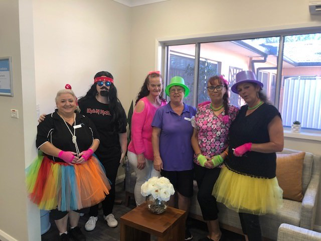 Wyong staff members dressed up in 80's clothes for trivia night