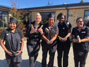 The staff at Japara St Judes holding chocolate easter eggs