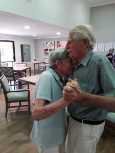 Two Noosa residents dancing together