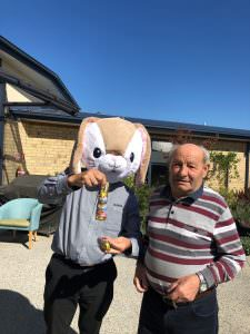 A St judes resident standing next to the 'easter bunny'