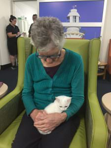 A South West Rocks residents holding a cat in her lap