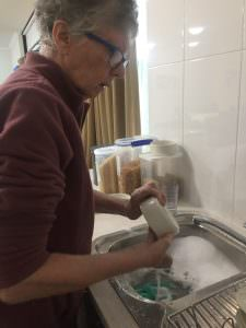 A South West Rocks resident washing the dishes