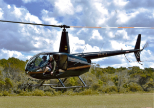 Gympie resident Eric in a helicopter preparing for take off