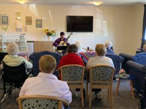 Dylan playing guitar for The Homestead residents