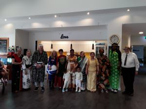 Residents and staff dressed in different cultural outfits for Harmony Day