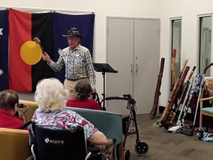 A member of the RSL performs a traditional anzac song for residents