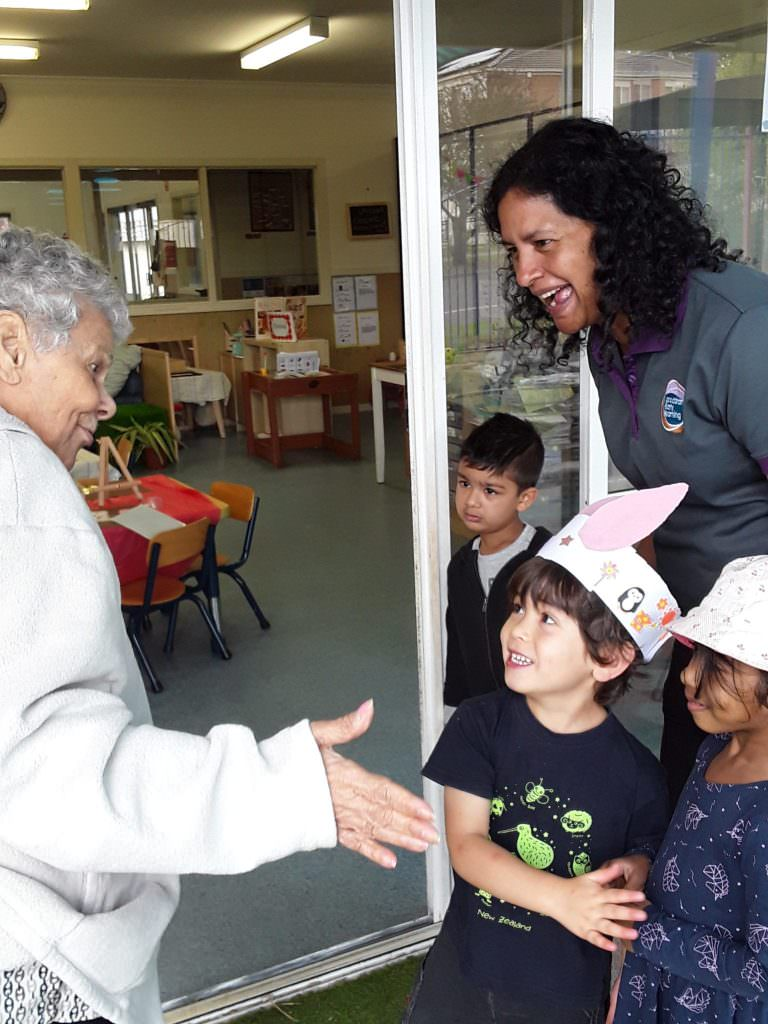 A St Judes resident interacting with kindergarten children