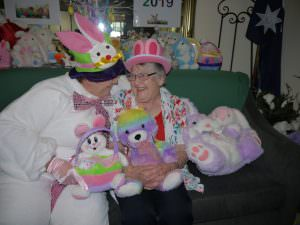 residents talks with the easter bunny as they smile and laugh