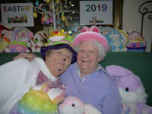 Resident and easter bunny share a hug as they smile for a photo