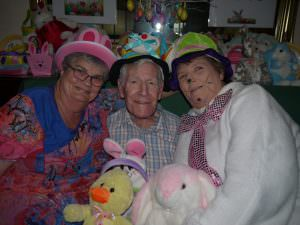 two residents and the easter bunny pose for a photo