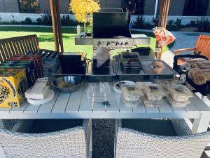 A table of food and drinks cooked from the bbq