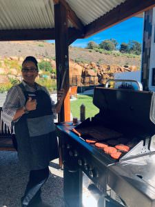 a staff member cooking a bbq