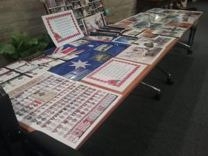 A table of Anzac related items such as a display of the different medals