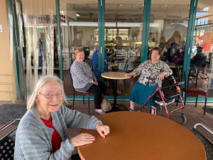 Residents enjoying each others company at The Homestead bakery