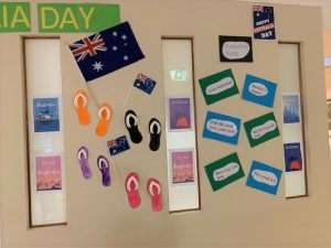 Wall art display of Australia flags and colourful paintings