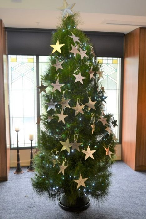 Large Christmas tree decorated in gold stars